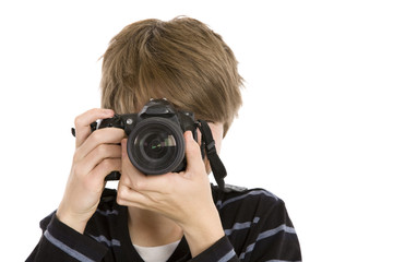 A teenager taking a photograph facing forward.