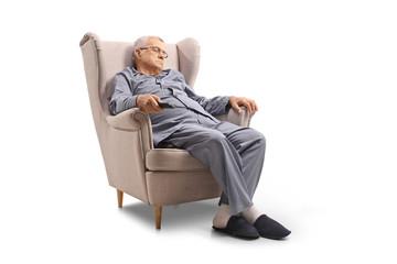 Mature man sleeping in an armchair
