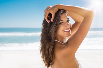 Beautiful woman on beach smiling