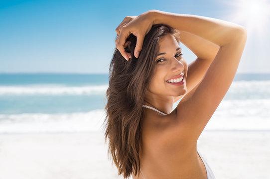 Beautiful woman on beach smiling