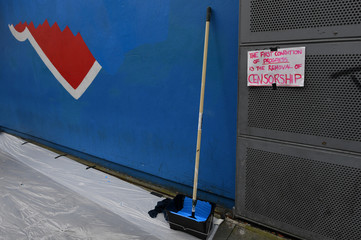 A sign and paintbrush are seen in front of the Project Arts Centre after a Pro-Choice 'Repeal the 8th Amendment' mural was painted over for a second time after the Irish charities regulator ordered it be removed again in Dublin