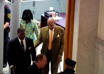 Actor and comedian Bill Cosby walks with his publicist Andrew Wyatt, during his sexual assault retrial at the Montgomery County Courthouse in Norristown, Pennsylvania