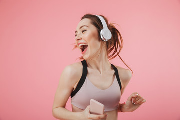 Happy young fitness sports woman