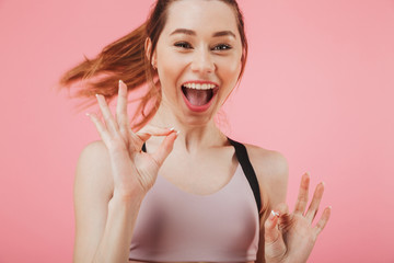 Cheerful young fitness sports woman running