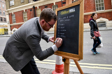 Joe Crilly, a spokesperson from the bookmaker William Hill, writes the names and betting odds for the third royal baby of Britain's Prince William and Catherine, Duchess of Cambridge, on a board outside the Lindo Wing St Mary's Hospital in west London