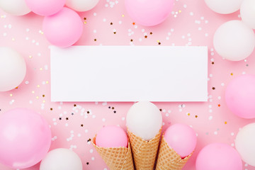 Party or birthday mockup with paper card, pastel balloons and confetti on pink table top view. Flat...