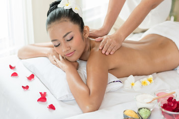 woman lying down on a massage bed at a spa