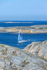 Sailboat in the rocky sea coast