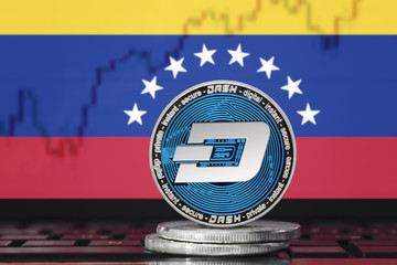 DASH (DigitalCash) cryptocurrency; concept physical dash coin on the background of the flag of Venezuela