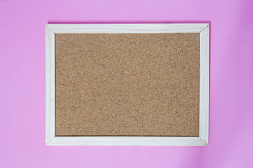 Isolate of wooden pin frame on pink background