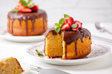 Small Vanilla And Strawberries Cakes With Chocolate Topping