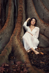 Woman in white under tree
