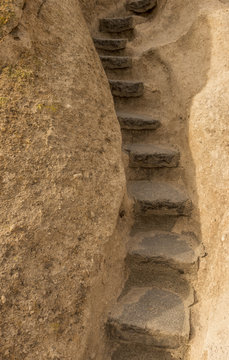 Stone steps leading up through a rock crevice at Bandelier National Monument, New Mexico, USA.