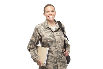 Happy female airman with books and bags