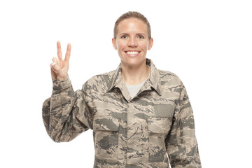 Female airman with peace sign