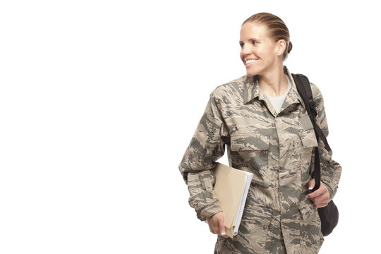 Female airman with books and bag