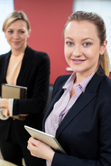 Portrait Of Young Businesswoman With Felame Mentor In Office