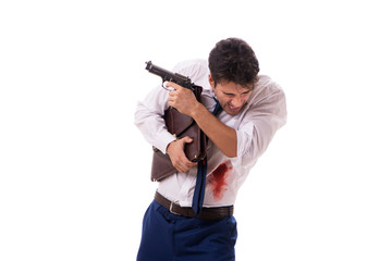 Businessman wounded in gun fight isolated on white