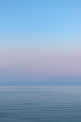 Colorful sunset sky and sea  with blurred motion.