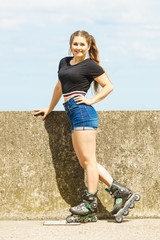 Fit girl with roller skates outdoor