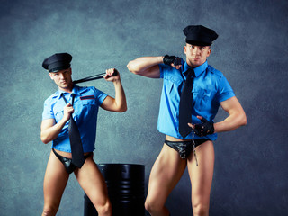 striptease dancers policemen