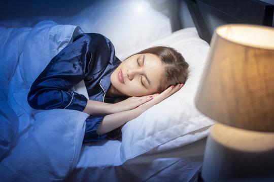 Beautiful woman is sleeping in bedroom