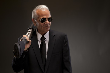 Businessman holding shotgun