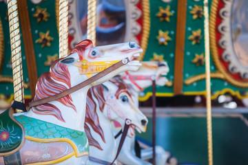 Beautiful nostalgic colorful vintage carousel merry-go-round horse ride