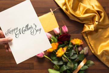 table with mothers day card with bouquet of beutiful flowers