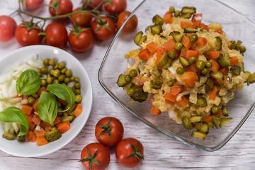 tasty potato salad in mycelium laid on the table, ingredients in lettuce - potatoes majneza carrot cucumbers traditional Slovak peas