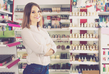 female customer posing in cosmetics store