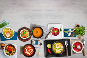 Different soups served on white wooden table. Concept of healthy traditional and ethnic food and dishes. Top view. Copy space.