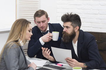 Business partners, businessmen at meeting, office background. Bosses interviewing woman for hiring. Businessman ask questions from cv, resume, about experience and skills. Job interview concept.