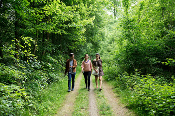 Group of friends walking in forest