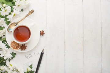 Tea with flowers is made with love. Top view with empty space for inscriptions