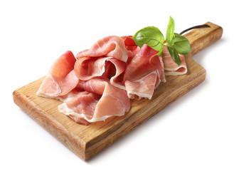 prosciutto on wooden cutting board