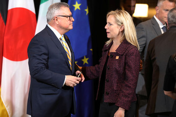 U.S. Secretary of Homeland Security Kirstjen Nielsen talks with Canada's Minister of Public Safety Ralph Goodale while waiting for a group photo to be taken
