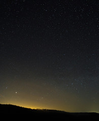 The stars in the night sky. A view of the starry space background sunset illuminated the horizon.