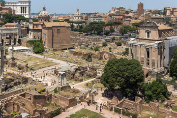 Panoramic view from Palatine Hill to ruins of Roman Forum in city of Rome, Italy