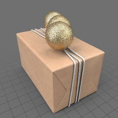 Wrapped present with gold balls