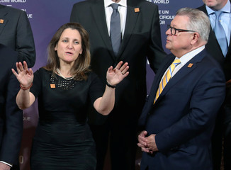 Canada's Minister of Foreign Affairs Freeland and Canada's Minister of Public Safety Goodale wait to take a group photo during meetings for foreign ministers from G7 countries in Toronto