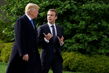 U.S. President Donald Trump and French President Emmanuel Macron walk from the Oval Office of the White House in Washington