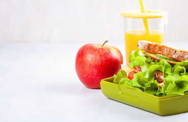 Healthy and fresh sandwich, apple and orange juice for student lunch