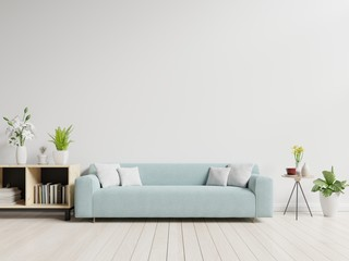 Empty living room with blue sofa, plants and table on empty white wall background. 3D rendering.