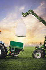 Wall Mural - transportation of fertilizers takes place in the fields with the participation of professional machines