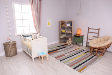 Baby room interior with comfortable crib and papasan chair