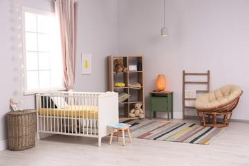 Baby room interior with comfortable crib and papasan chair