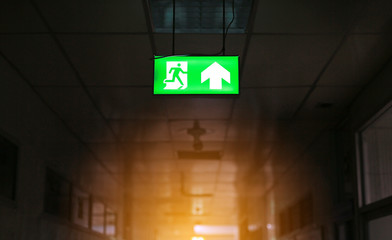 green emergency exit sign in public building.