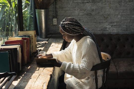 Portrait of black woman with dreadlocks hair
