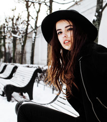 young pretty teenage hipster girl outdoor in winter snow park ha